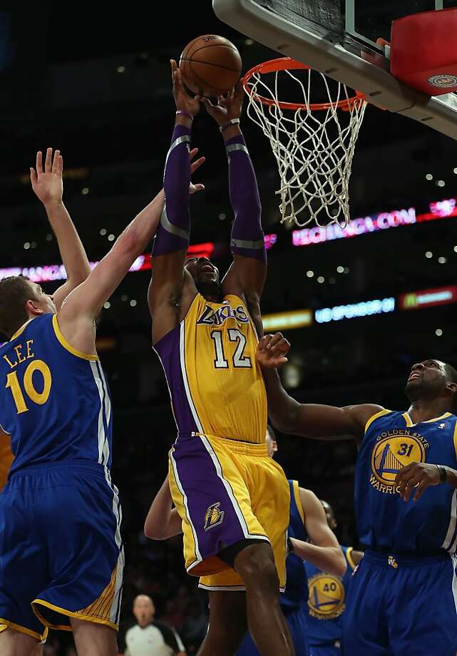 LOS ANGELES, CA - NOVEMBER 09:  Dwight Howard #12 of the Los Angeles Lakers goes up for a rebound while defended by David Lee (L) #10 and Festus Ezeli #31 of the Golden State Warriors in the first half at Staples Center on November 9, 2012 in Los Angeles, California. NOTE TO USER: User expressly acknowledges and agrees that, by downloading and or using this photograph, User is consenting to the terms and conditions of the Getty Images License Agreement.  (Photo by Jeff Gross/Getty Images) Photo: Jeff Gross, Getty Images