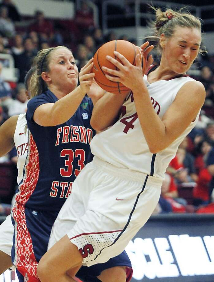 Joslyn Tinkle (right), who scored 20 for Stanford, fights Fresno State's Taylor Thompson for the ball. Photo: George Nikitin, Associated Press