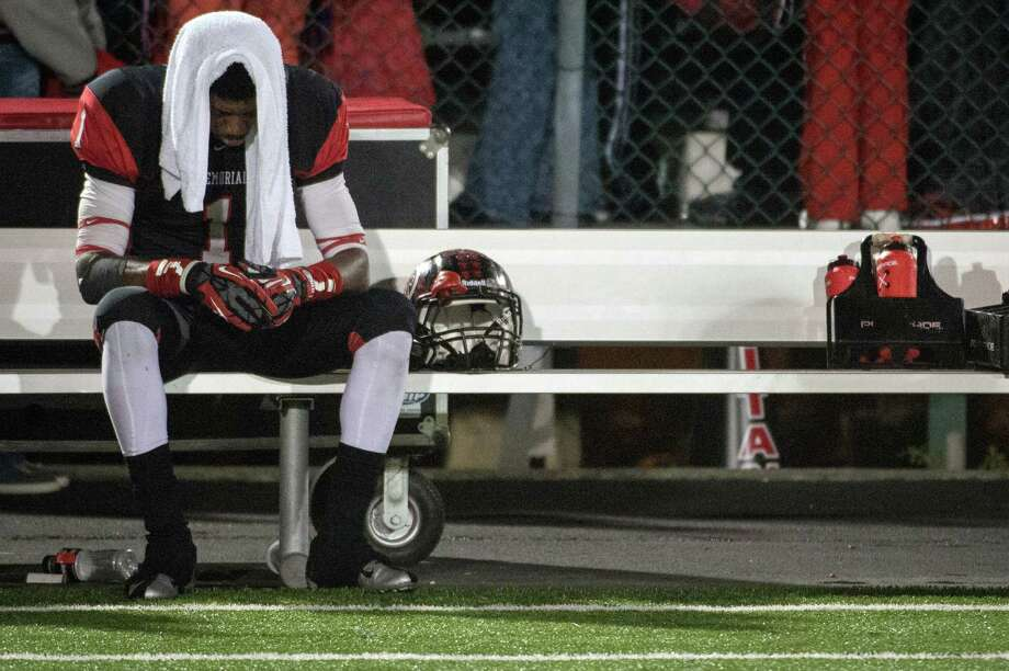 Port Arthur Memorial defensive back Jalen Barnes sits alone on the bench following a 37-33 loss to La Porte in a high school football game at  Memorial Stadium, Saturday, Nov. 10, 2012, in Port Arthur. ( Smiley N. Pool / Houston Chronicle ) Photo: Smiley N. Pool, Staff / © 2012  Houston Chronicle