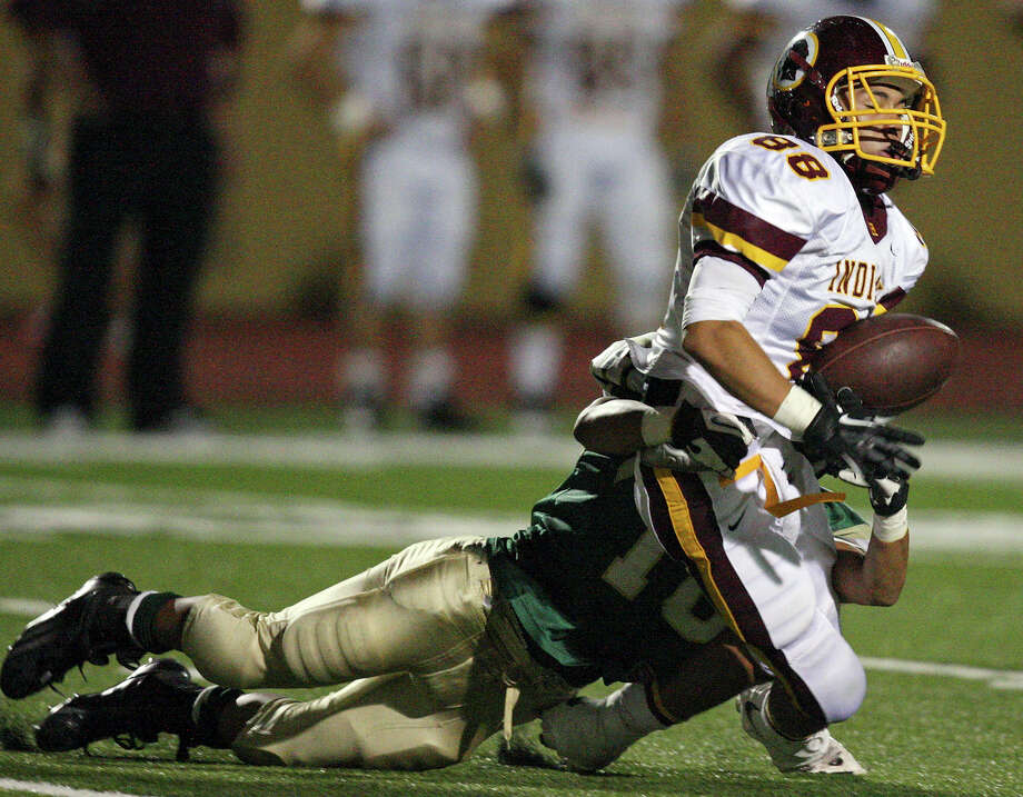 Harlandale's James Mendoza fumbles the kickoff as he is hit by McCollum's Jeff Valdez during second half action of the Frontier Bowl Friday Nov. 9, 2012 at Harlandale Memorial Stadium. Harlandale won in double overtime 43-36. Photo: Edward A. Ornelas, Express-News / © 2012 San Antonio Express-News