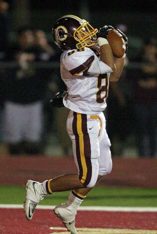 Harlandale's James Mendoza catches a pass in the end zone for a touchdown against McCollum during second half action of the Frontier Bowl Friday Nov. 9, 2012 at Harlandale Memorial Stadium. Harlandale won in double overtime 43-36. Photo: Edward A. Ornelas, Express-News / © 2012 San Antonio Express-News