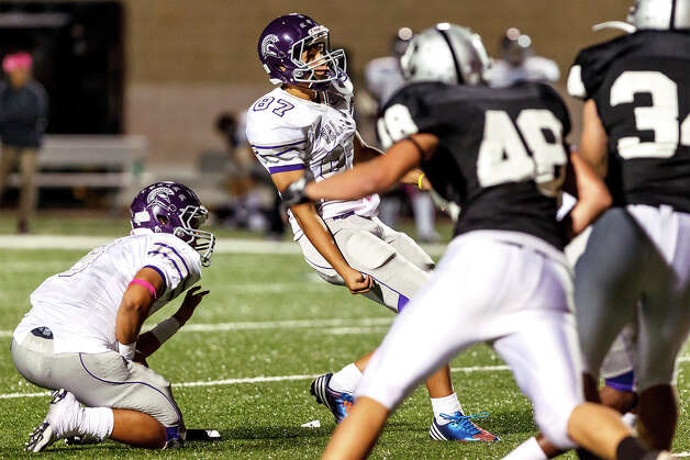 Warren's Leo Montemayor (center) watches as his 37-yard field goal ties the game at 20-20 with 44 seconds remaining in during their game with Clark at Farris Stadium on Nov. 9, 2012.  Clark claimed a spot in the playoffs with a 27-26 overtime victory over the Warriors.  MARVIN PFEIFFER/ mpfeiffer@express-news.net Photo: MARVIN PFEIFFER, Express-News / Express-News 2012