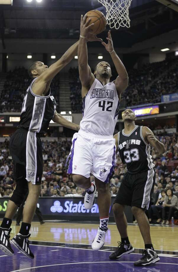 San Antonio Spurs  forward Tim Duncan, left, blocks the shot of Sacramento Kings forward Chuck Hayes, as Spurs canter Boris Diaw, of France looks on during the fourth quarter of an NBA basketball game in Sacramento, Calif., Friday, Nov. 9, 2012.  The Spurs won 97-86.(AP Photo/Rich Pedroncelli) (Associated Press)