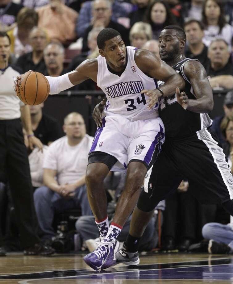 Sacramento Kings forward drives against San Antonio Spurs forward DeJuan Blair during the third quarter of an NBA basketball game in Sacramento, Calif., Friday, Nov. 9, 2012.  The Spurs won 97-86.(AP Photo/Rich Pedroncelli) (Associated Press)
