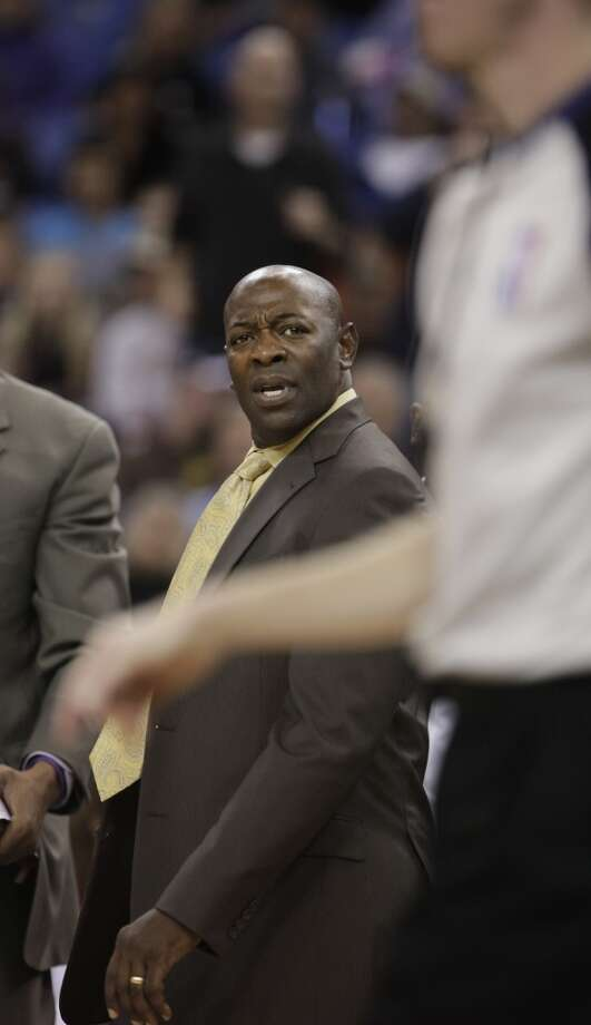 Sacramento Kings head coach Keith Smart glares at official Ed Malloy after a foul was called on the Kings during the fourth quarter of an NBA basketball game against the San Antonio Spurs in Sacramento, Calif., Friday, Nov. 9, 2012.  The Spurs won 97-86.(AP Photo/Rich Pedroncelli) (Associated Press)