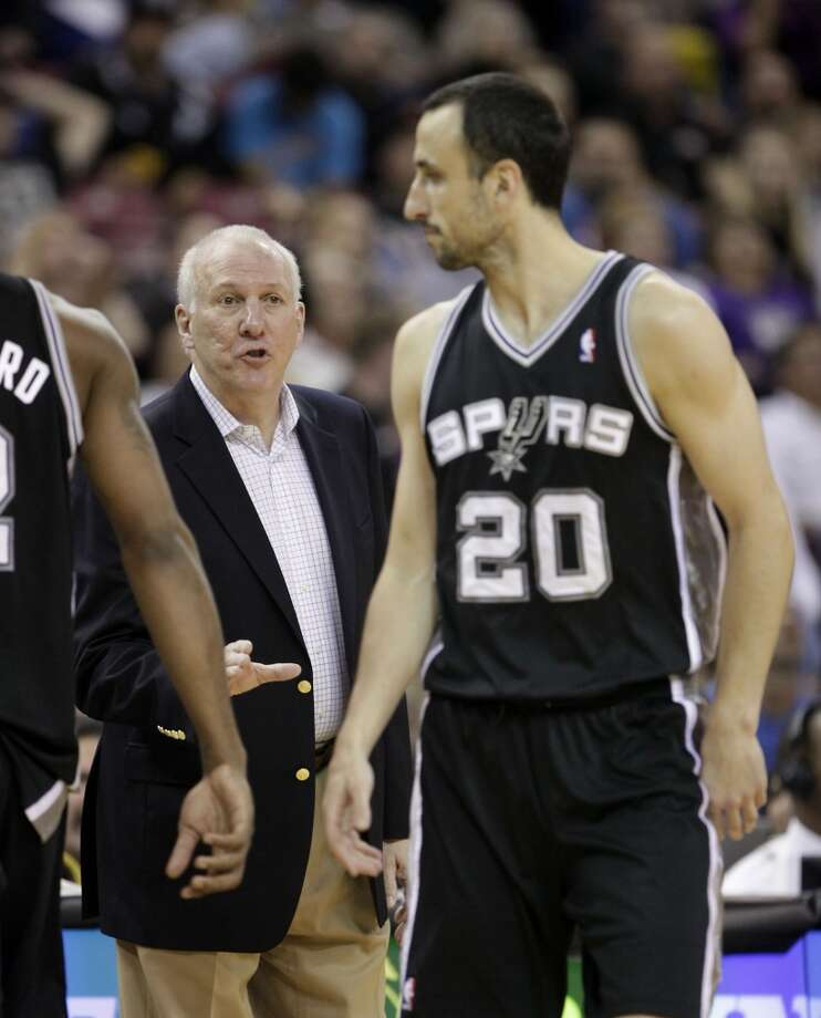 San Antonio Spurs head coach Greg Popovich, left, calls out instructions to San Antonio Spurs guard Manu Ginobili, of Argentina, during  the third quarter of an NBA basketball game against the Sacramento Kings in Sacramento, Calif., Friday, Nov. 9, 2012.  The Spurs won 97-86.(AP Photo/Rich Pedroncelli) (Associated Press)
