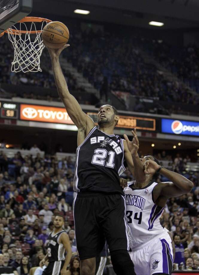 San Antonio Spurs forward Tim Duncan, right, goes to the basket past Sacramento Kings forward Jason Thompson during third quarter of an NBA basketball game in Sacramento, Calif., Friday, Nov. 9, 2012.  The Spurs won 97-86.(AP Photo/Rich Pedroncelli) (Associated Press)