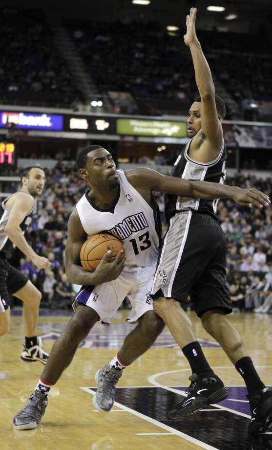 Sacramento Kings guard Tyreke Evans, left, tries to get around San Antonio Spurs guard Patty Mills during the fourth quarter of an NBA basketball game in Sacramento, Calif., Friday, Nov. 9, 2012.  The Spurs won 97-86.(AP Photo/Rich Pedroncelli) (Associated Press)