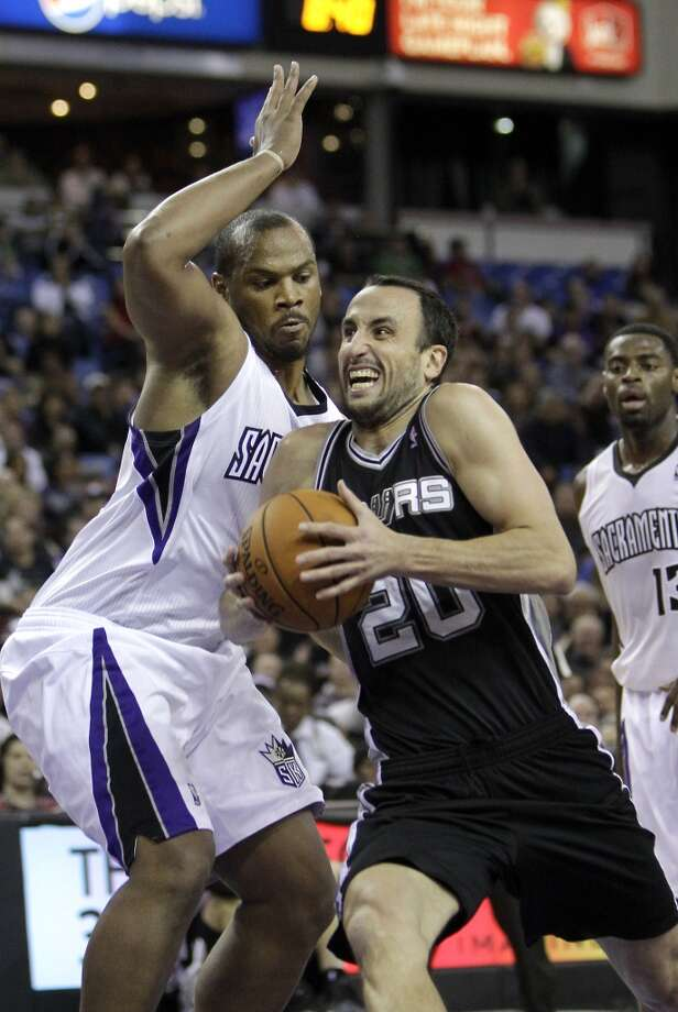 San Antonio Spurs guard Manu Ginobili, right, drives to the basket against Sacramento Kings forward Chuck Hayes during the third quarter of an NBA basketball game in Sacramento, Calif., Friday, Nov. 9, 2012.  The Spurs won 97-86.(AP Photo/Rich Pedroncelli) (Associated Press)