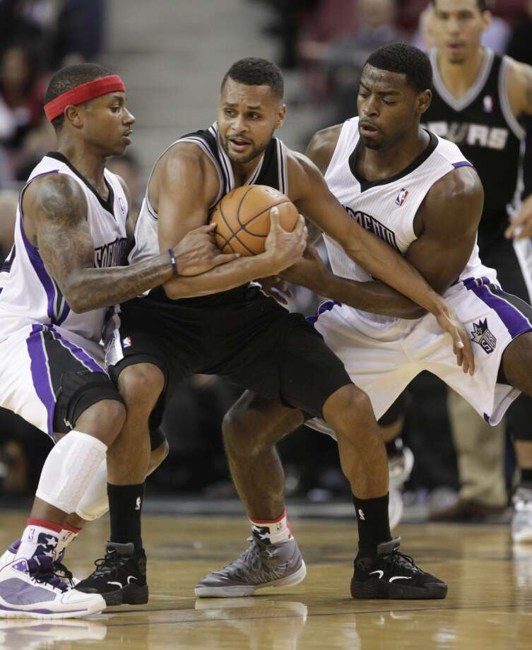 San Antonio Spurs  guard Patty Mills, of Australia, center, is double teamed by Sacramento Kings Isaiah Thomas, left, andTyreke Evans   during the fourth quarter of  an NBA basketball game in Sacramento, Calif., Friday, Nov. 9, 2012.  The Spurs won 97-86.(AP Photo/Rich Pedroncelli) (Associated Press)