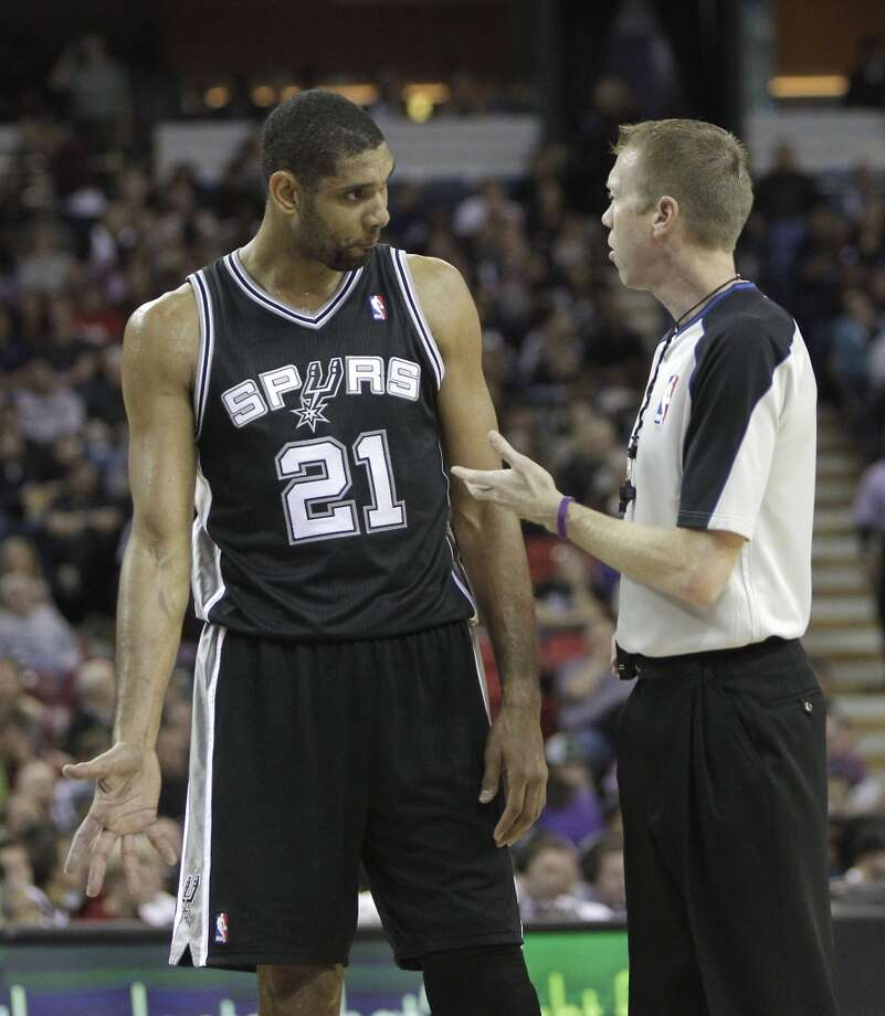 San Antonio Spurs  forward Tim Duncan  talks with official Ed Malloy during a timeout in an NBA basketball game against the Sacramento Kings in Sacramento, Calif., Friday, Nov. 9, 2012.  The Spurs won 97-86.(AP Photo/Rich Pedroncelli) (Associated Press)