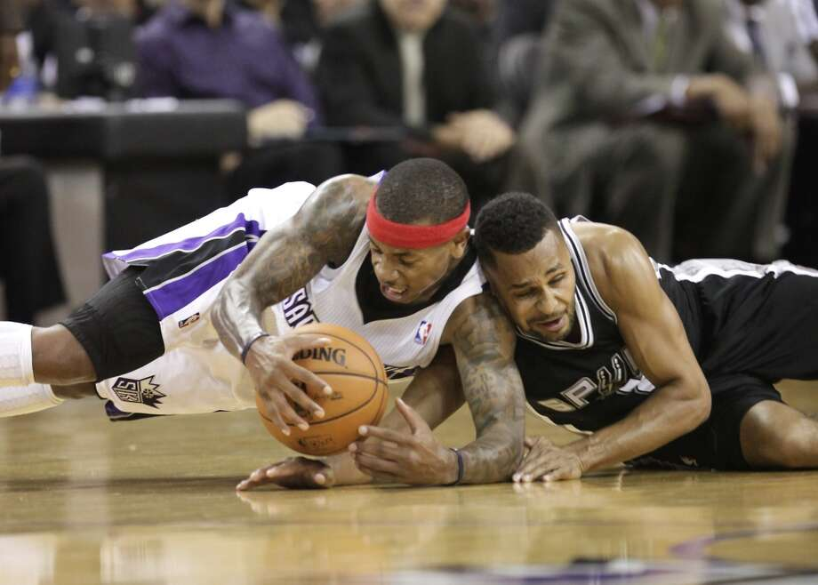Sacramento Kings guard Isaiah Thomas, left, collides with San Antonio Spurs guard Patty Mills, of Australia, during the fourth quarter of an NBA basketball game in Sacramento, Calif., Friday, Nov. 9, 2012.  The Spurs won 97-86.(AP Photo/Rich Pedroncelli) (Associated Press)