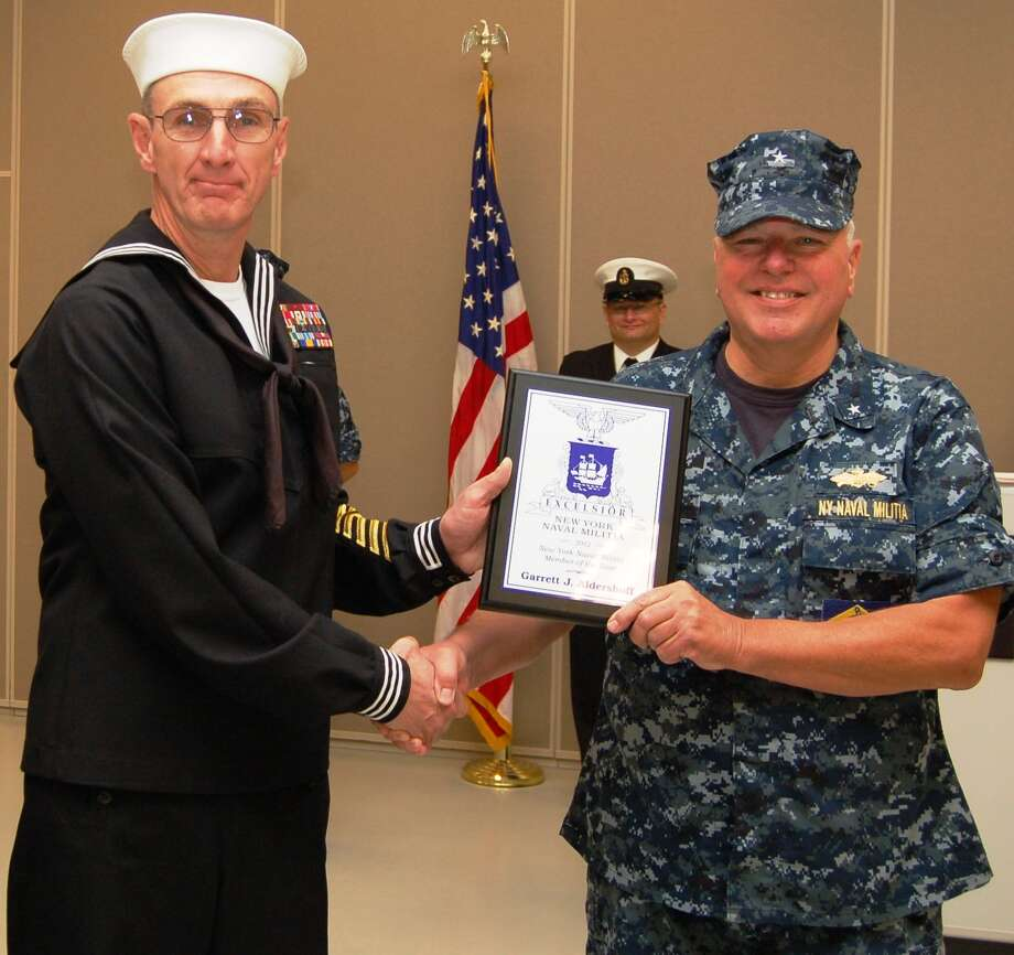 NAVAL MILITIA Navy information Systems Tech Garrett Aldershoff, left, of Scotia, holds the Josephthal Award received from Rear Adm. David Tucker.