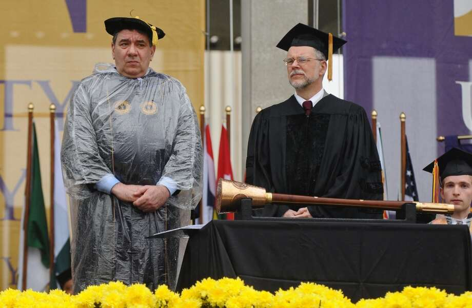 "UAlbany President George M. Philip, left, stands with undergraduate ceremony speaker Gregory P. Maguire, Class of 1976, before his speech during the UAlbany commencement ceremony on Sunday May 15, 2011 in Albany, NY. Maguire, an author who grew up in Albany, wrote ""Wicked: The Life & Times of the Wicked Witch of the West."" The commencement program said that the book was the inspiration for the Broadway musical, ""Wicked."" ( Philip Kamrass / Times Union (Albany Times Union)"