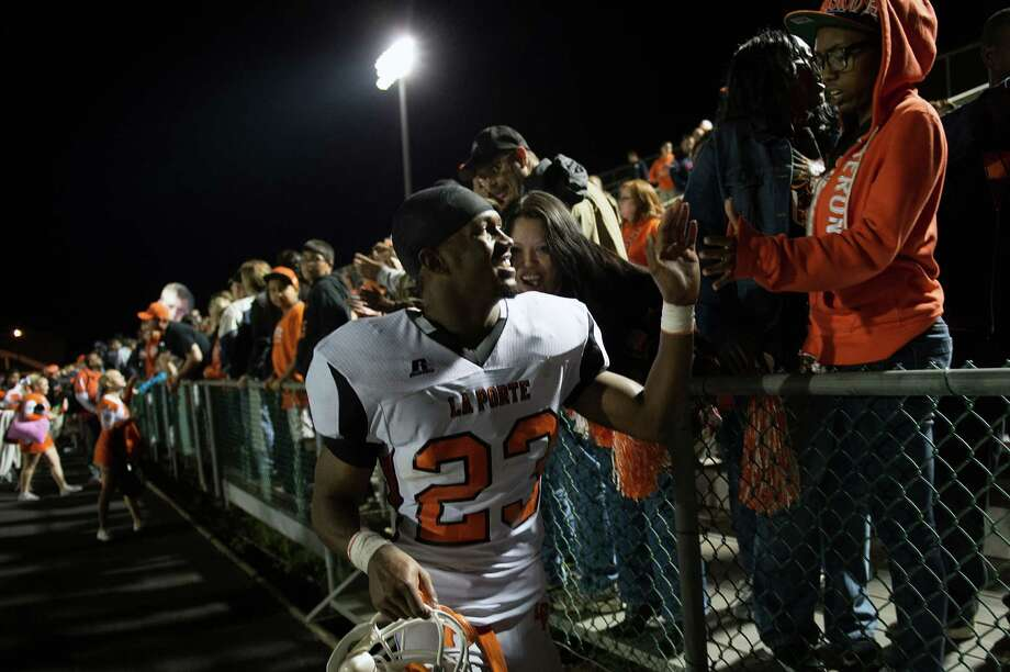 La Porte running back Johnathan Lewis high-fives fans following the Bulldogs victory over Port Arthur Memorial in a high school football game at  Memorial Stadium, Friday, Nov. 9, 2012, in Port Arthur. Photo: Smiley N. Pool, Houston Chronicle / © 2012  Houston Chronicle