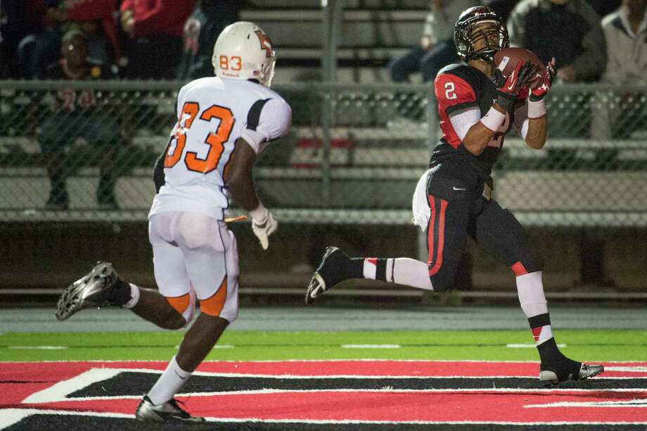 Port Arthur Memorial wide receiver John Leday (8) catches a 19-yard touchdown pass as La Porte's Jahvey Mark (83) defends during the second half of a high school football game at  Memorial Stadium, Friday, Nov. 9, 2012, in Port Arthur. Photo: Smiley N. Pool, Houston Chronicle / © 2012  Houston Chronicle