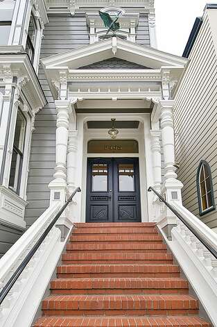 A classic, red-brick path leads to the entrance of this 1900 Victorian estate that is detached on both sides. Photo: Open Homes Photography