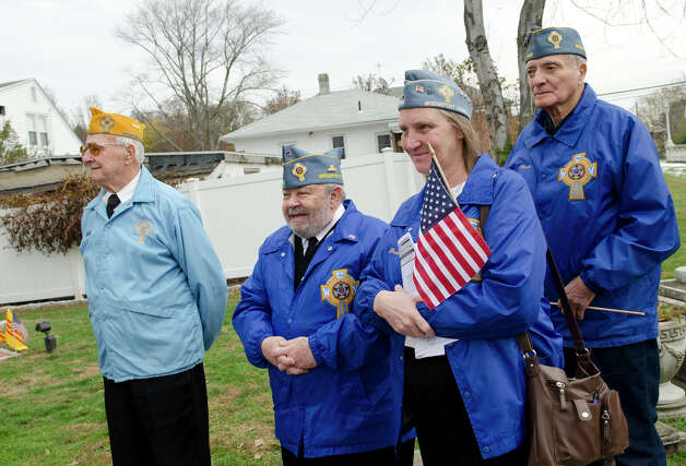 Catholic War Veterans Post 1466 members from left, Post Commander WWII Army Veteran Walter Stachacz, who served in the South Pacific for 33 months; Korean War Army Veteran Mike Totora, Barb Totora, and Korean War Army Veteran Henry Romero, participate in the third annual Veterans Day Mass and Ceremony at St. Margaret Shrine on Park Ave. in Bridgeport on Saturday, Nov. 10, 2012. Participants in the ceremony included South Vietnamese Military Veterans, the Greater Bridgeport Detachment of the Marine Corps League, Port 5 Naval Veterans, and the Catholic War Veterans Post 1466. Photo: Amy Mortensen / Connecticut Post Freelance