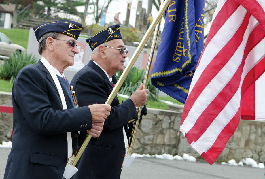 U.S. Air Force Veteran Bernard Capodagli, who served from 1951-1954; and U.S. Navy Veteran Andy Fabry, who served from 1955-1961, participate in the third annual Veterans Day Mass and Ceremony at St. Margaret Shrine on Park Ave. in Bridgeport on Saturday, Nov. 10, 2012. Participants in the ceremony included South Vietnamese Military Veterans, the Greater Bridgeport Detachment of the Marine Corps League, Port 5 Naval Veterans, and the Catholic War Veterans Post 1466. Photo: Amy Mortensen / Connecticut Post Freelance