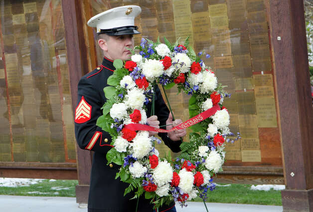 U.S. Marine Corps Veteran Michael Benedetto, carries the Memorial wreath during the third annual Veterans Day Mass and Ceremony at St. Margaret Shrine on Park Ave. in Bridgeport on Saturday, Nov. 10, 2012. Participants in the ceremony included South Vietnamese Military Veterans, the Greater Bridgeport Detachment of the Marine Corps League, Port 5 Naval Veterans, and the Catholic War Veterans Post 1466. Photo: Amy Mortensen / Connecticut Post Freelance