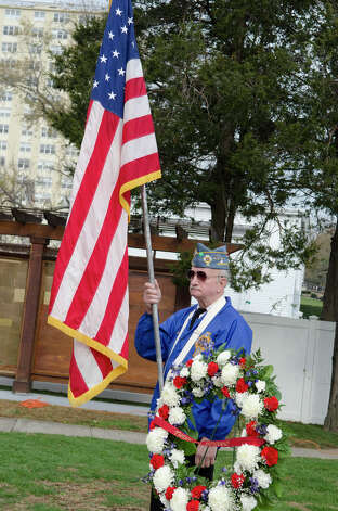 U.S. Army Veteran Ken Jones, who served in 1953, of the Catholic War Veterans Post 1466, carries the American flag during the third annual Veterans Day Mass and Ceremony at St. Margaret Shrine on Park Ave. in Bridgeport on Saturday, Nov. 10, 2012. Participants in the ceremony included South Vietnamese Military Veterans, the Greater Bridgeport Detachment of the Marine Corps League, Port 5 Naval Veterans, and the Catholic War Veterans Post 1466. Photo: Amy Mortensen / Connecticut Post Freelance