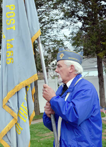 U.S. Navy Veteran Al Neudeck, who served during the Vietnam War, of the Catholic War Veterans Post 1466, carries the Post 1466 flag during the third annual Veterans Day Mass and Ceremony at St. Margaret Shrine on Park Ave. in Bridgeport on Saturday, Nov. 10, 2012. Participants in the ceremony included South Vietnamese Military Veterans, the Greater Bridgeport Detachment of the Marine Corps League, Port 5 Naval Veterans, and the Catholic War Veterans Post 1466. Photo: Amy Mortensen / Connecticut Post Freelance