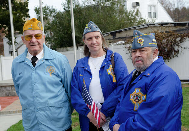 Catholic War Veterans Post 1466 members from left, Post Commander WWII Army Veteran Walter Stachacz, who served in the South Pacific for 33 months; Barb Totora and her husband Korean War Army Veteran Mike Totora participate in the third annual Veterans Day Mass and Ceremony at St. Margaret Shrine on Park Ave. in Bridgeport on Saturday, Nov. 10, 2012. Participants in the ceremony included South Vietnamese Military Veterans, the Greater Bridgeport Detachment of the Marine Corps League, Port 5 Naval Veterans, and the Catholic War Veterans Post 1466. Photo: Amy Mortensen / Connecticut Post Freelance