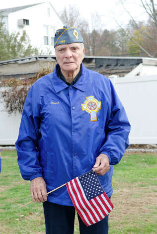 Catholic War Veterans Post 1466 member and Korean War Army Veteran Henry Romero participates in the third annual Veterans Day Mass and Ceremony at St. Margaret Shrine on Park Ave. in Bridgeport on Saturday, Nov. 10, 2012. Participants in the ceremony included South Vietnamese Military Veterans, the Greater Bridgeport Detachment of the Marine Corps League, Port 5 Naval Veterans, and the Catholic War Veterans Post 1466. Photo: Amy Mortensen / Connecticut Post Freelance