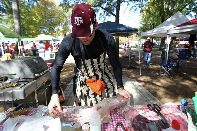 Joe Calao, of Waco, tailgates before the start of a college football game at Bryant-Denny Stadium, S