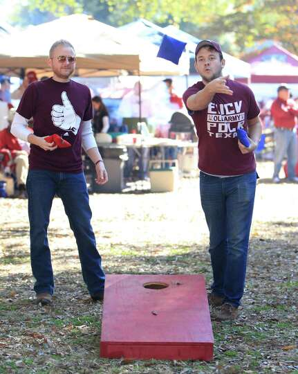 Justin Dalton, left, and Collin Brewer, of Houston, right,  both Texas Aggie alums,  tailgate on the