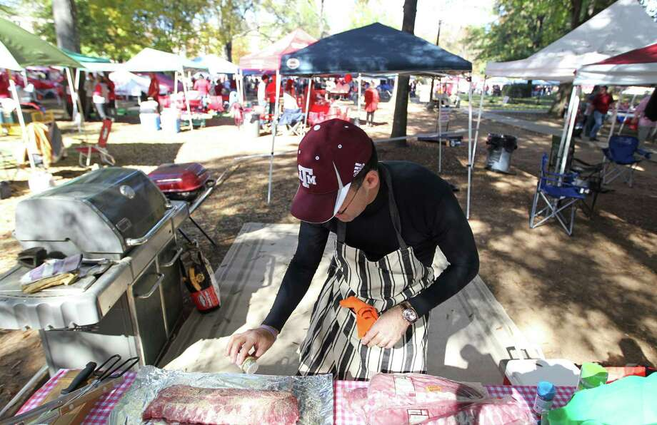 Joe Calao, of Waco, tailgates before the start of a college football game at Bryant-Denny Stadium, Saturday, Nov. 10, 2012, in Tuscaloosa. Calao's son, Anthony, goes to school at Alabama. Photo: Karen Warren, Houston Chronicle / © 2012  Houston Chronicle