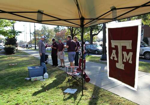 "Texas Aggie alums tailgate on the ""quad"" before the start of a college football game at Bryant-Denny Stadium, Saturday, Nov. 10, 2012, in Tuscaloosa. Photo: Karen Warren, Houston Chronicle / © 2012  Houston Chronicle"