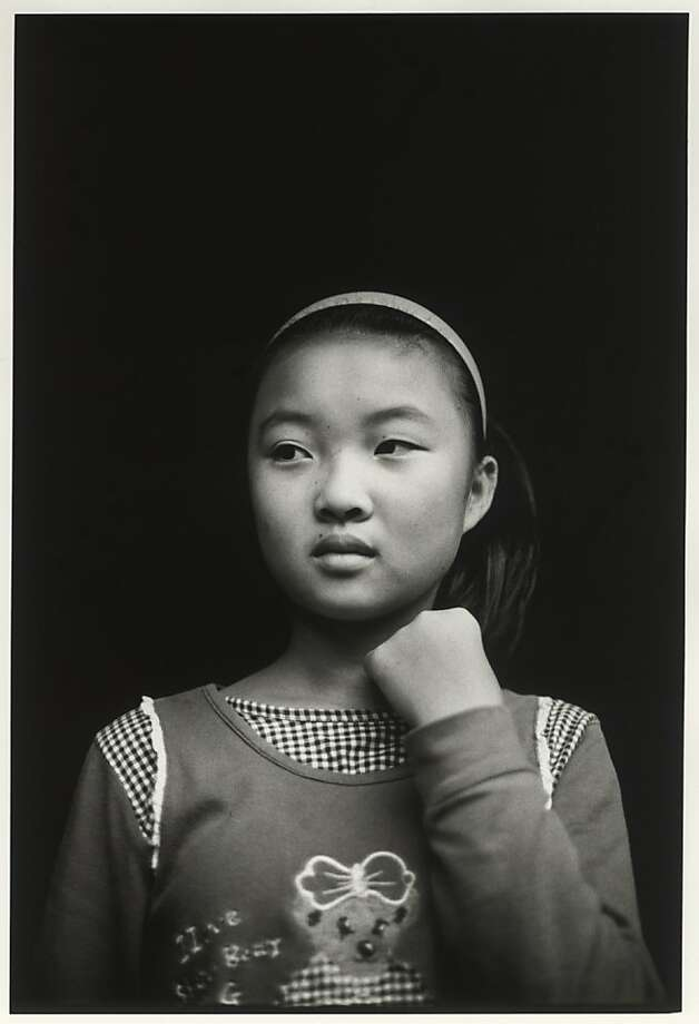 Photos of everyday life in China by Kirk Crippens are among those on exhibit. Photo: Kirk Crippens