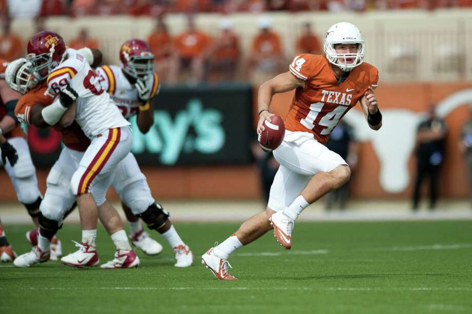 Texas quarterback David Ash scrambles against Iowa State. Photo: Cooper Neill, Getty Images / 2012 Getty Images
