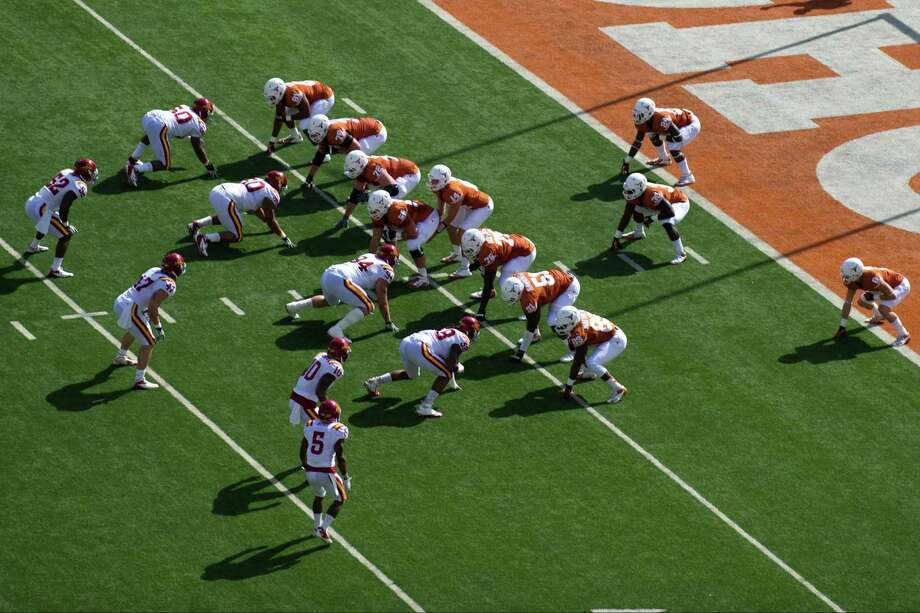 The Texas Longhorns line up in the wishbone formation for the first play in honor of Darrell K. Royal. Photo: Cooper Neill, Getty Images / 2012 Getty Images