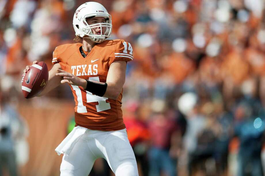 AUSTIN, TX - NOVEMBER 10:  David Ash #14 of the Texas Longhorns throws a pass during the Big 12 Conference game against the Iowa State Cyclones on November 10, 2012 at Darrell K Royal-Texas Memorial Stadium in Austin, Texas. Photo: Cooper Neill, Getty Images / 2012 Getty Images
