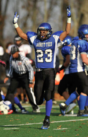 Abbott Tech's Josh Espinal celebrates after a recovered fumble during their game against Platt Tech at Broadview Middle School on Saturday, Nov. 10, 2012. Abbott Tech won, 12-7. Photo: Jason Rearick / The News-Times