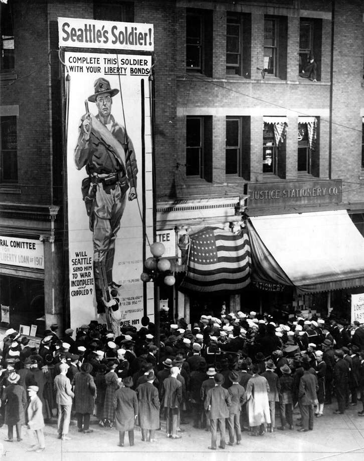 This soldier marked the number of bonds sold at the Liberty Loan headquarters at Second Avenue and Marion Street in Seattle. This picture by an unnamed P-I staff photographer ran Oct. 28, 1917. Photo: Seattlepi.com File