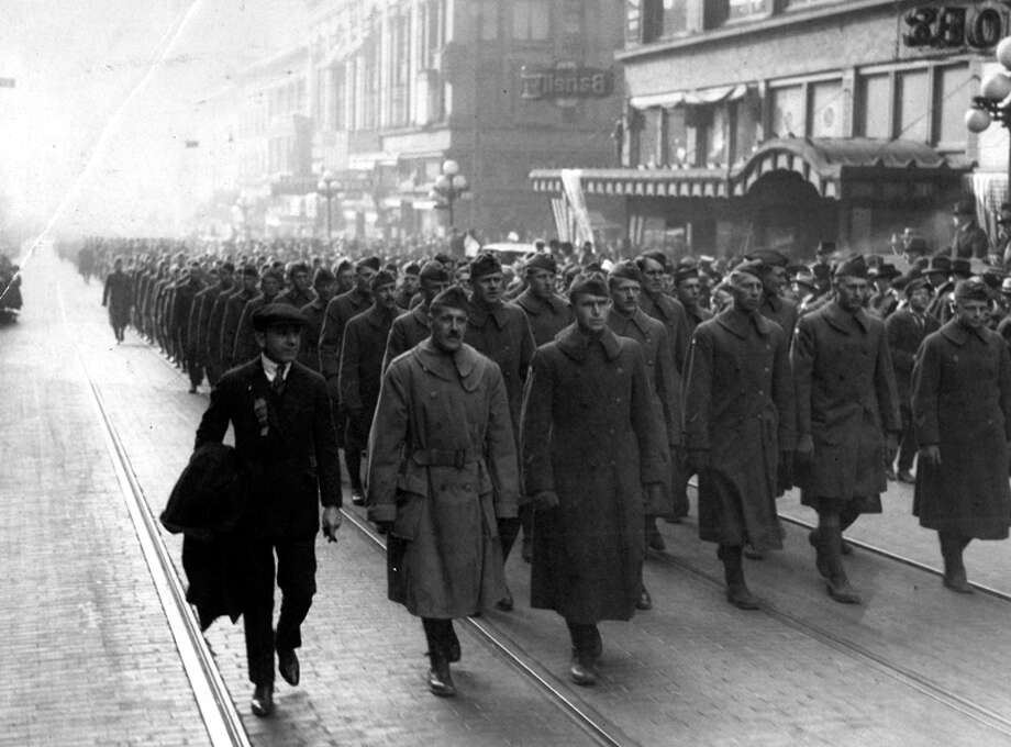 This World War I-era P-I photo shows men marching on Second Avenue in Seattle. Photo: Seattlepi.com File