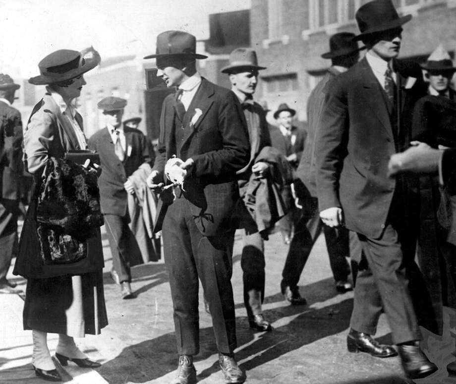 """This picture from 1917 shows a man leaving on a train for Camp Lewis saying goodbye """"to the girl he left behind,"""" the caption read. Photo: Seattlepi.com File"""