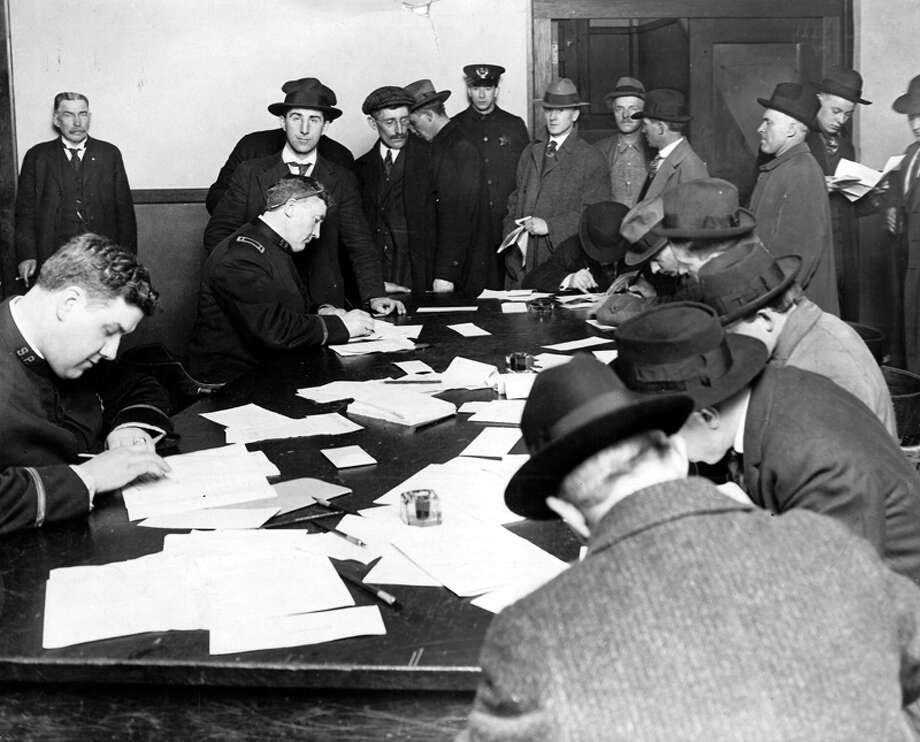 "This picture, published in the P-I on Feb. 6m 1918, shows ""alien enemy registration"" at Seattle Police headquarters. Photo: Seattlepi.com File"