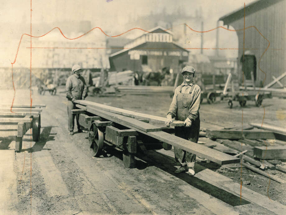 "This picture, published in the P-I May 21, 1918, was taken in Aberdeen to show World War I service at home. The caption by photographer A.C. Cirard read: ""Women engaged in piling and stacking lumber in the yards of the Aberdeen Lumber and Shingle company plant."" Photo: Seattlepi.com File"