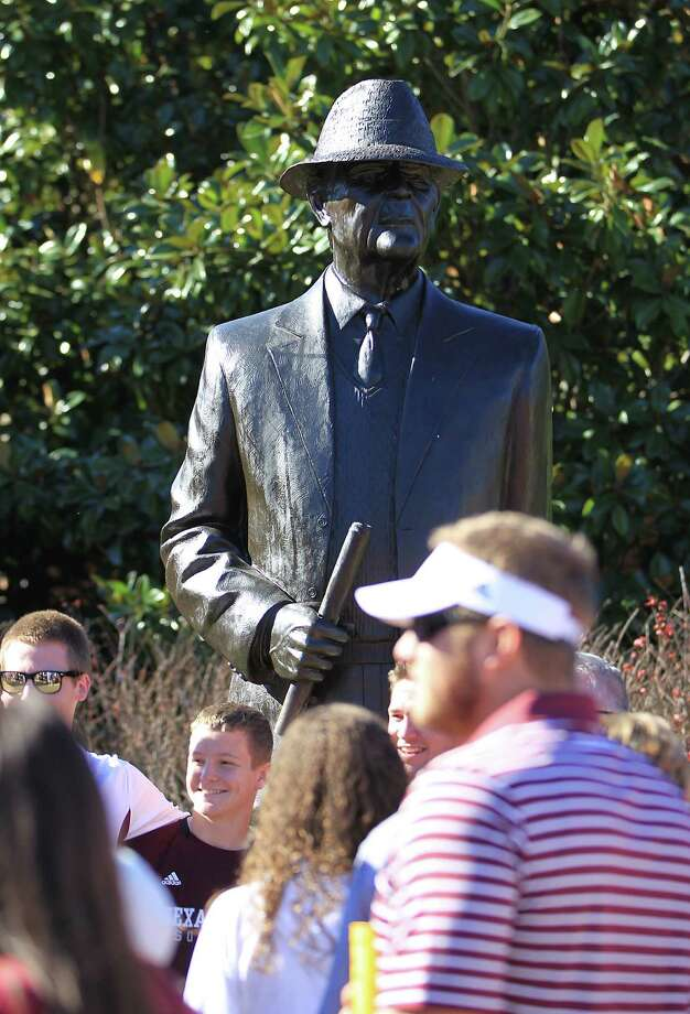 Texas A&M and Alabama fans swarm around the Bear Bryant statue before the start of a college football game at Bryant-Denny Stadium, Saturday, Nov. 10, 2012, in Tuscaloosa. Photo: Karen Warren, Houston Chronicle / © 2012  Houston Chronicle
