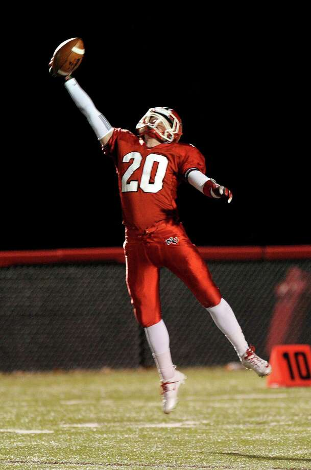 New Canaan's Andrew Read makes a one-handed catch during Friday's football game against Stamford at New Canaan High School on November 9, 2012. Photo: Lindsay Niegelberg / Stamford Advocate