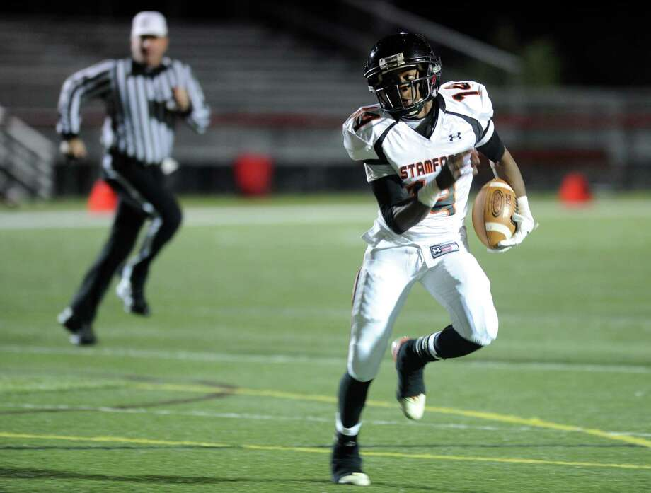 Stamford's Jalen Brown carries the ball during Friday's football game at New Canaan High School on November 9, 2012. Photo: Lindsay Niegelberg / Stamford Advocate