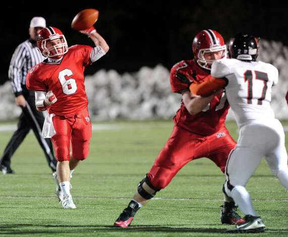New Canaan's Teddy Bossidy throws a pass during Friday's football game against Stamford at New Canaan High School on November 9, 2012. Photo: Lindsay Niegelberg / Stamford Advocate