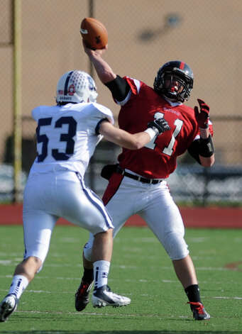 Fairfield Warde's Max Garrett passes the ball as Staples' Brian Book defends Saturday, Nov. 10, 2012 at Fairfield Warde High School. Photo: Autumn Driscoll / Connecticut Post