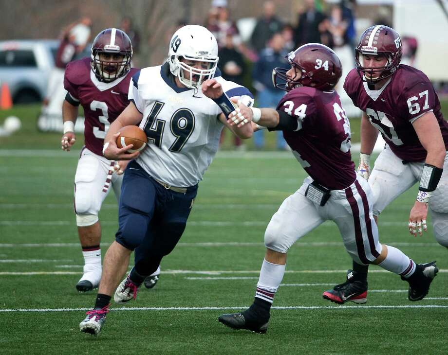King's Alex Haendler carries the ball with pressure from St. Luke's Noah Daniel during the FAA game at St. Luke's on Saturday, November 10.  Contributed Photo Photo: Contributed Photo / Stamford Advocate Contributed