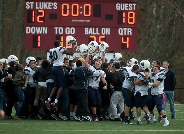 King football celebrates its 18-12 win over St. Luke's in New Canaan on Saturday, November 10.  Contributed photo Photo: Contributed Photo / Stamford Advocate Contributed