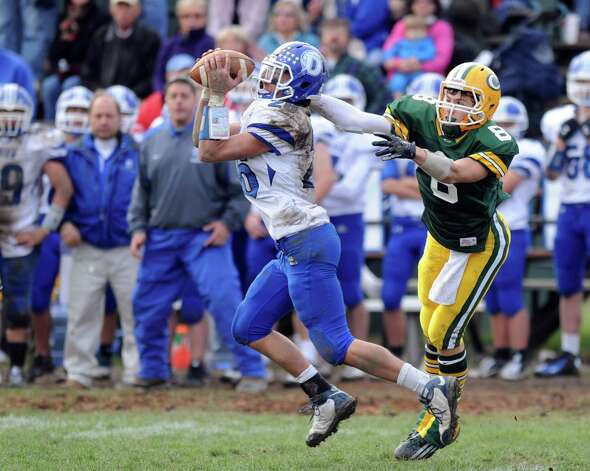 Darien's Peter Gesualdi intercepts a ball intended for Trinity Catholic's Connor Amann during Saturday's football game at Trinity Catholic High School on November 10, 2012. Photo: Lindsay Niegelberg / Stamford Advocate